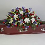 Red Rose, Blue Iris, Lilly Rosewood Floral Tribute